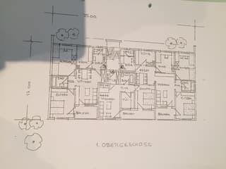 Mehrfamilienhaus mit 14 Wohneinheiten und 11 Garagen (2)