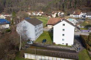 2 Mehrfamilienhäuser in Zentrumsnähe mit 15 Wohnungen, 11 Parkplätzen und 6 Garagenboxen (2)