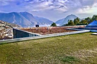 Wohnung in Porza mit privatem Garten & Blick auf den See zu verkaufen (2)