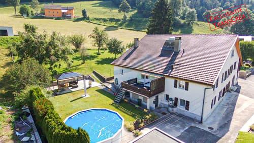 Maison familiale sur grand terrain de 1'220 m2 Jardin et box garage