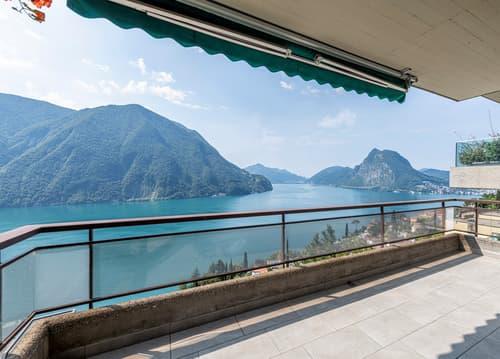 Appartamento rinnovato con spettacolare vista lago e piscina/ Renovier