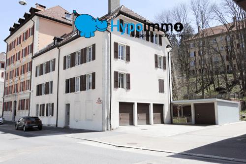 Immeuble de 4 appartements et garages