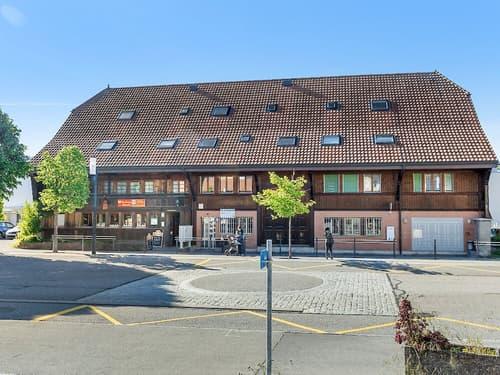 Mehrfamilienhaus mit Gewerberäumen in Corminboeuf