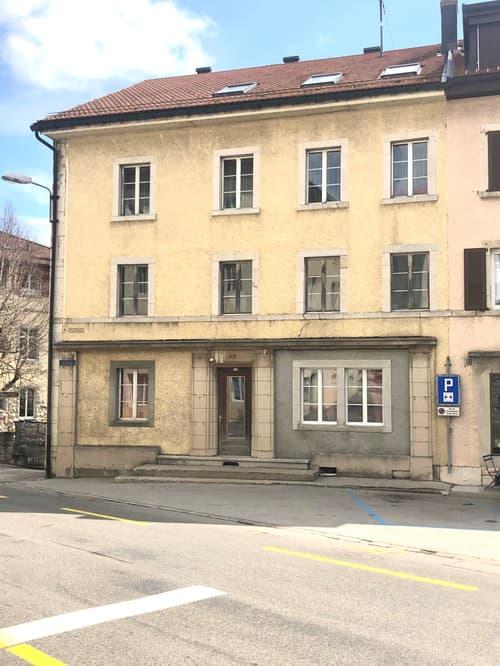 Immeuble locatif de cinq appartements avec six garages