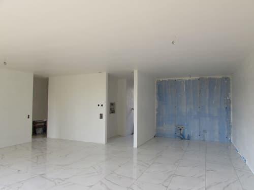 NUOVO appartamento di 4.5 loc. con giardino e terrazzo a Cadempino