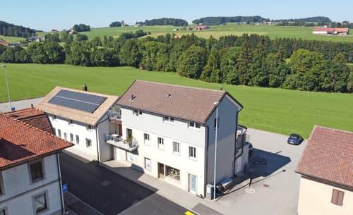 Immeuble mixte en bordure de zone agricole