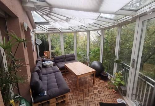 Wohnen wie im Einfamilienhaus mit Wintergarten und Garten