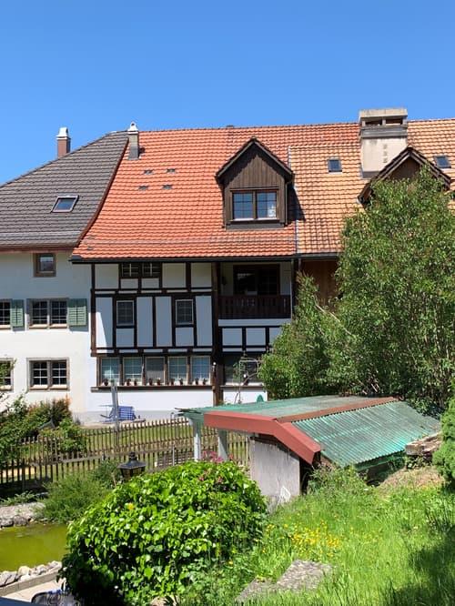 Flarzhausteil mit 3 Wohnungen und Werkstatt