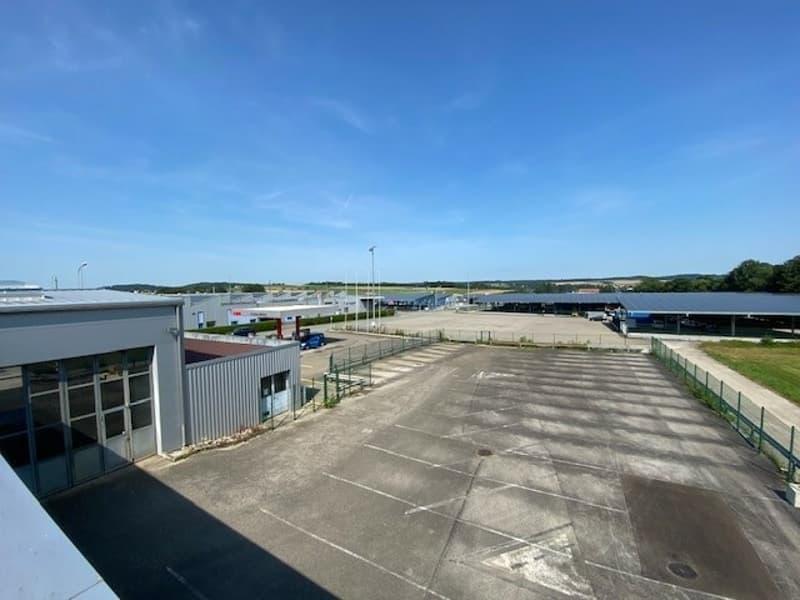 Ensemble de places de parc et garage à louer en zone industrielle (1)