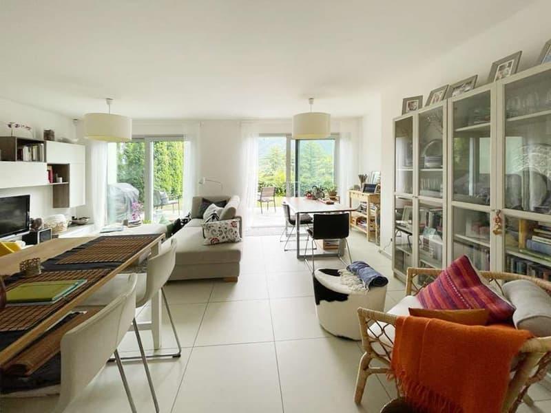 Appartamento 3,5 locali con giardino e vista lago (1)