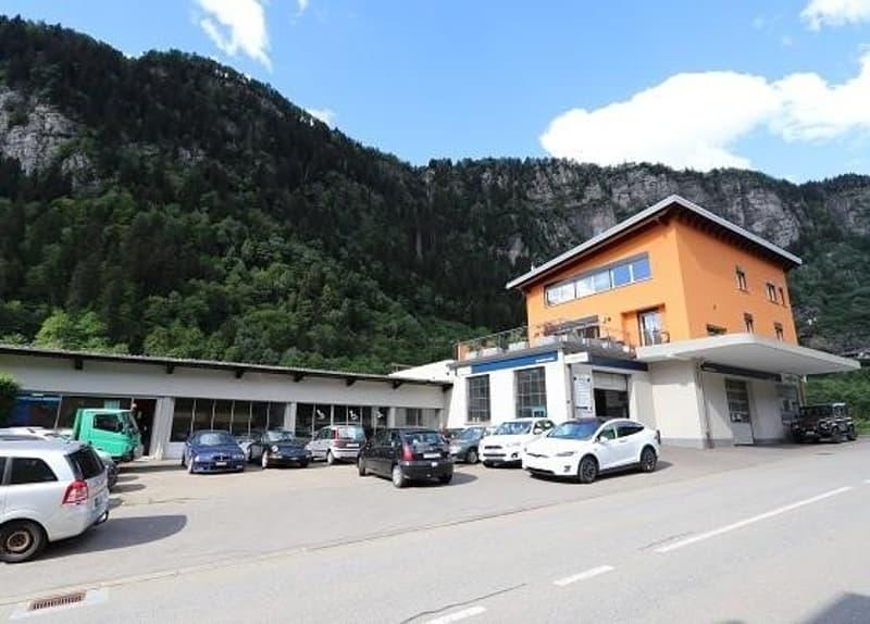 Autowerksatt mit 5 1/2-Zimmer-Maisonette sowie Baulandreserve / garage con appartamento duplex di 5 1/2 locali e terreno edificabile (1)