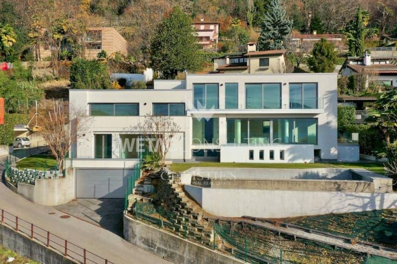 Grosszügige Villa mit Pool & herrlichen Seeblick auf den Luganer See zu verkaufen (1)