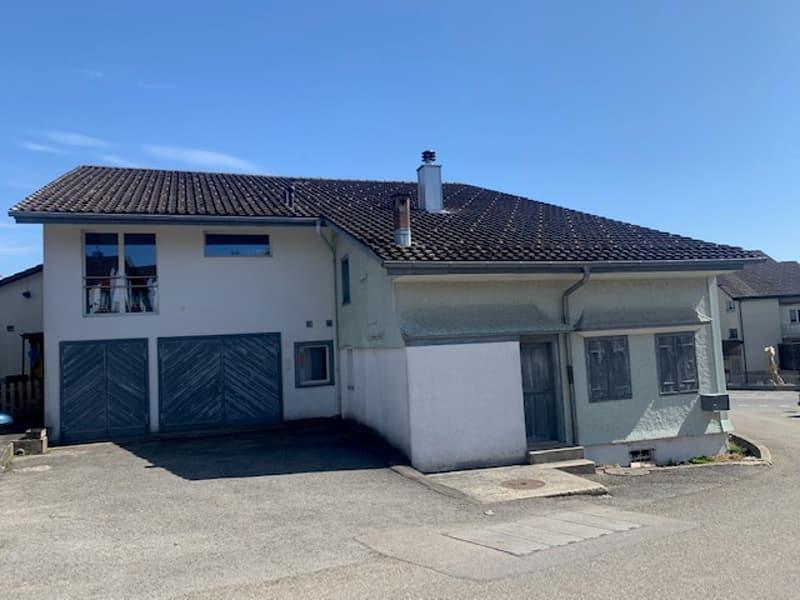 Ansicht Wohnhaus mit Garage